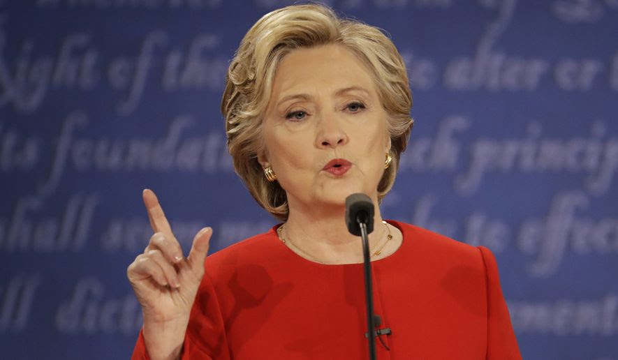 """""""I think implicit bias is a problem for everyone, not just police,"""" Hillary Clinton said. """"I think unfortunately too many of us in our great country jump to conclusions about each other and therefore I think we need all of us to be asked the hard questions 'why am I feeling this way?'"""" (Associated Press)"""