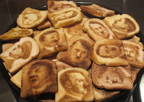 A pile of toast with various pictures of Hitler's face.