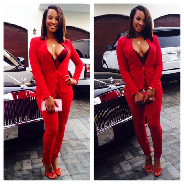 Savannah James's American Airlines Arena Isabel Marant Red Suit, Bustier, Charlotte Olympia Crown Top Clutch, and Alexander Birman Sandals