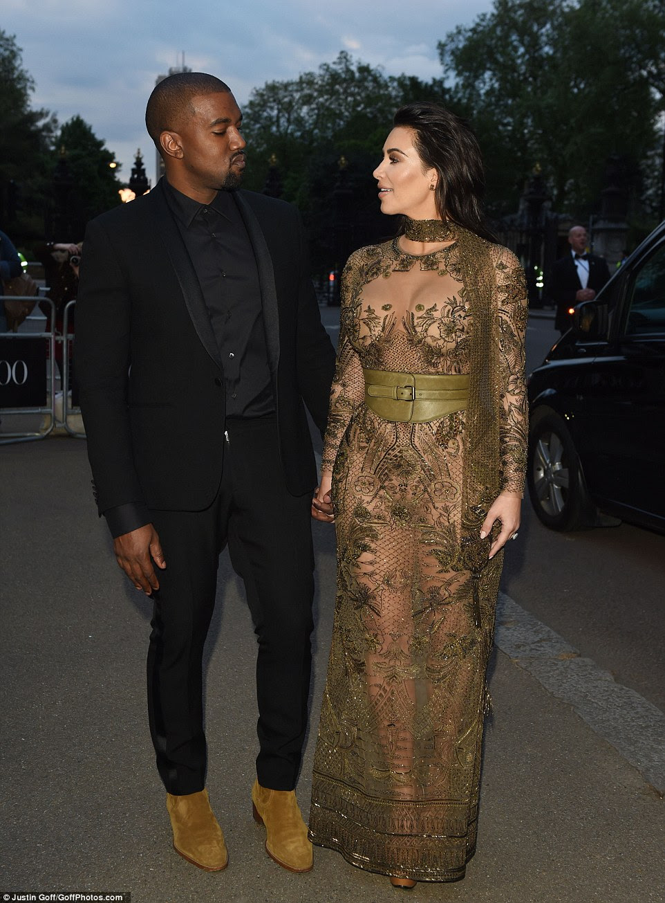 Loved up:Kanye, meanwhile, let his wife take the lead - wearing a simple all-black ensemble as he stared in awe at his stunning partner