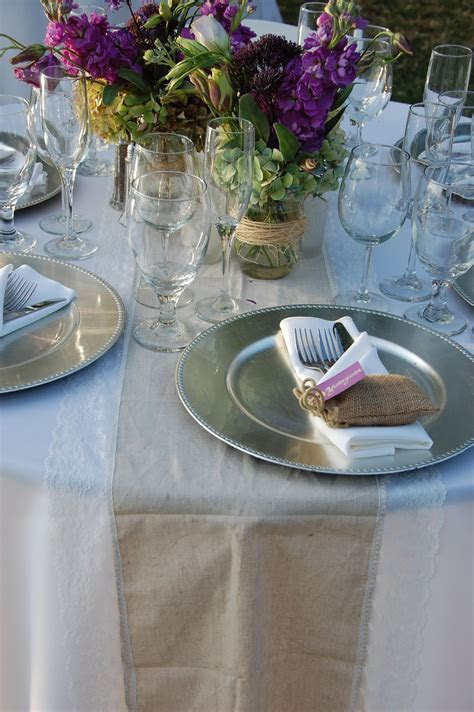 table set up with burlap runner and silver charger plate