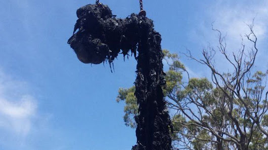 Giant 'fatberg' pulled out from under Australia by a crane