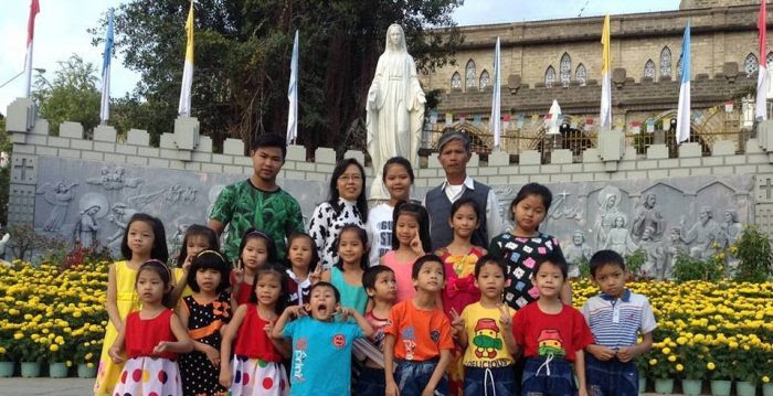 Tong and children from his orphanage. Photo via Facebook.