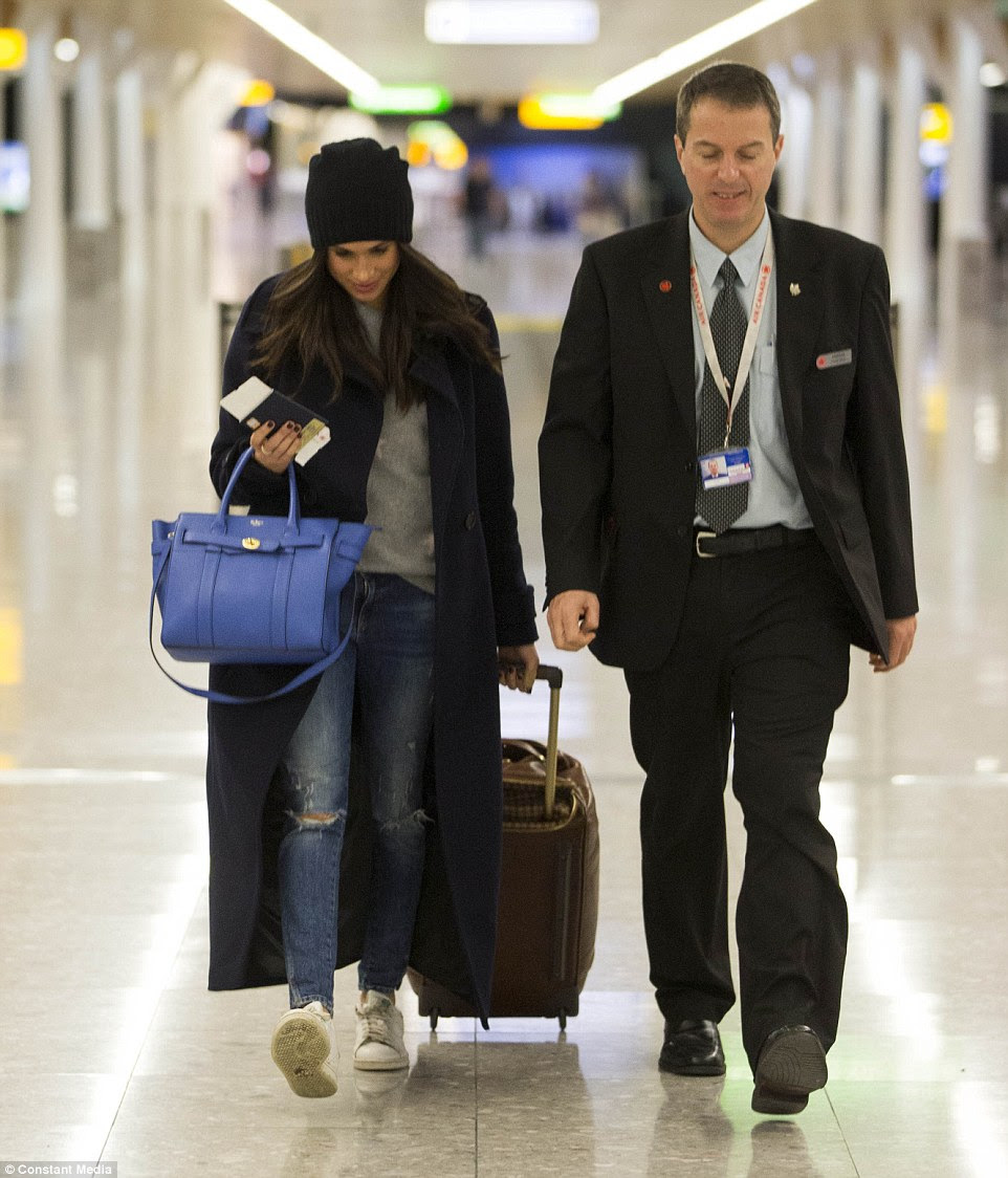 The casually dressed actress was accompanied by a member of airline staff as she made her way through Heathrow