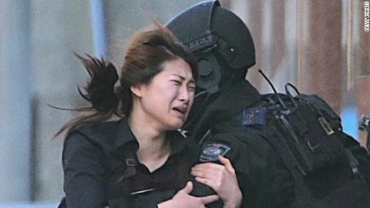 With two hostages and gunman dead, grim investigation starts in Sydney