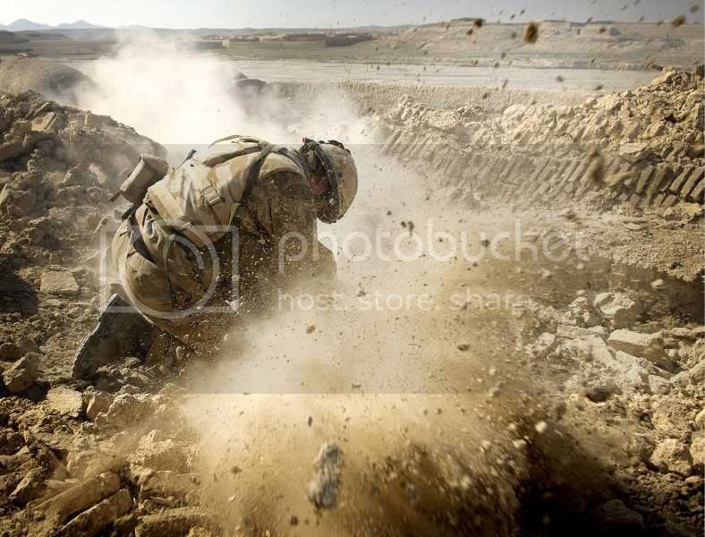 Royal Marine Commando from Britain\'s 11 Troop, M Company, 42 Commando fires 51mm light mortars in to the Afghan village of Chinah