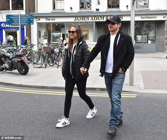 Nick kept the cold weather at bay wearing a dark fleece coat, and co-ordinated his look with grey and green trainers in keeping with the patriotic theme