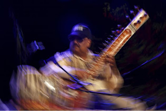 Indian sitar player Ashwin Batish performs with his Sitar Power band at the Ghanafest folk music festival in Floriana, outside Valletta