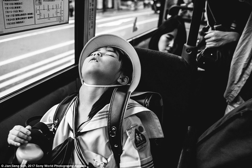 Photographer Jian Seng Soh, who captured this image in Kyoto, Japan, wrote of it: 'Before I got off the bus at the next station, I gave my seat to this young elementary student with heavy bags and she immediately fell asleep'