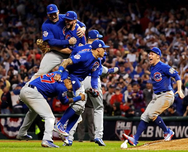 Chicago Cubs players celebrate after they win their first World Series title in 108 years...on November 2, 2016 (Pacific Time).
