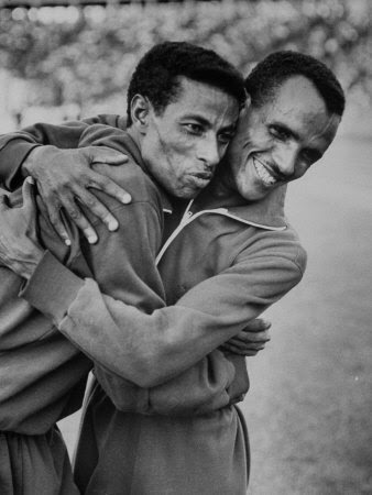 http://cache2.allpostersimages.com/p/LRG/38/3805/W3MIF00Z/posters/ethiopian-runners-abebe-bikila-and-mamo-wolde-during-exhibition-race-at-berlin-olympic-stadium.jpg