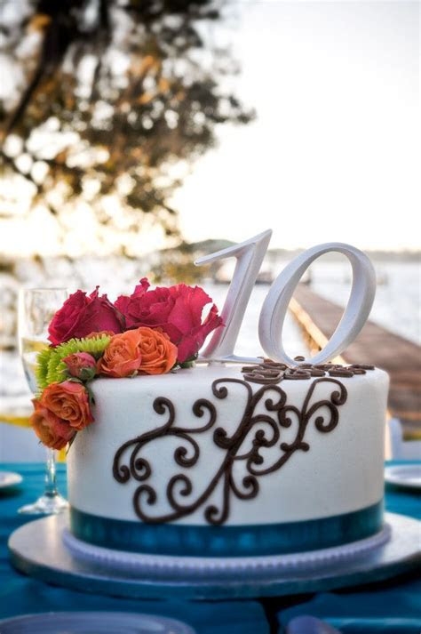 10th Anniversary cake with scroll design, teal ribbon and