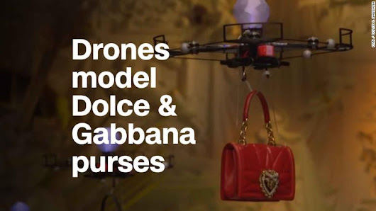 Drones model purses at Dolce & Gabbana fashion show