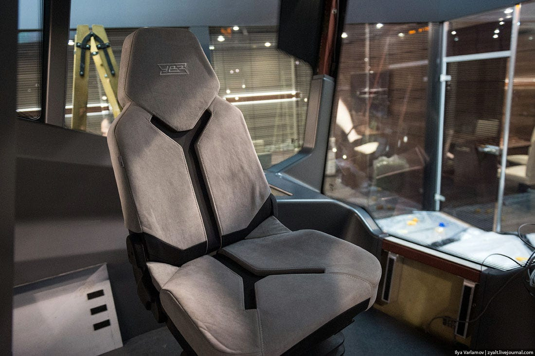 The driver's seat, which is covered in artificial suede.