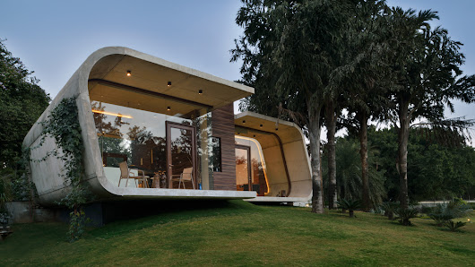 Indian pool house by 42mm Architecture has a concrete frame