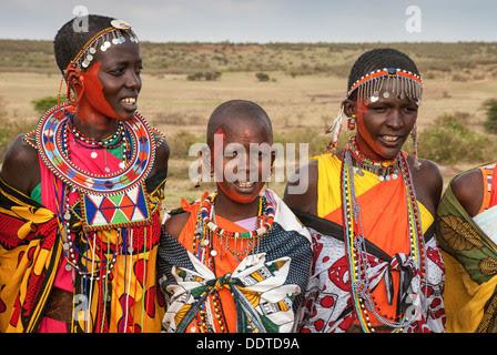 Masai women wearing traditional dress in a village near