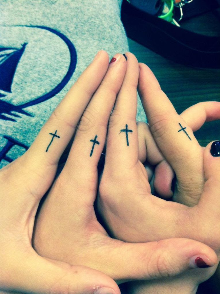 31 Wording And Bow Finger Tattoos
