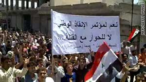 Syrian anti-government protesters march during a demonstration in the town of Kafr Nabel on Friday.