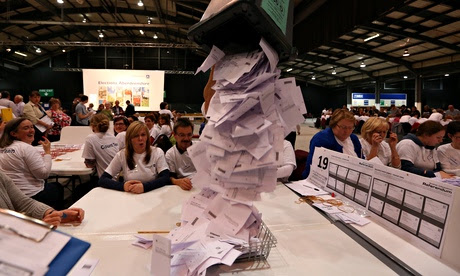 Ballot boxes are opened as counting begins in the Scottish referendum in Aberdeen