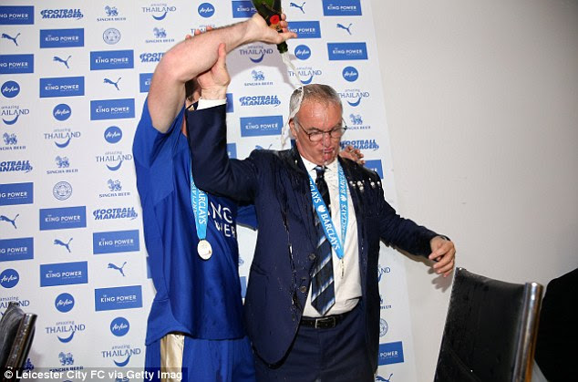 Fuchs empties a bottle of champagne over the Italian on the day Leicester received the title trophy
