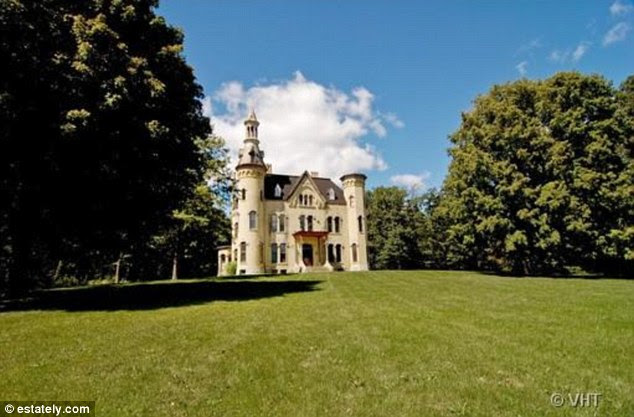 Real-life palace: This beautiful 1885 castle tucked away in Wayne, Illinois features five wood-burning fireplaces and a five-story spire while all together listed for $1,800,000