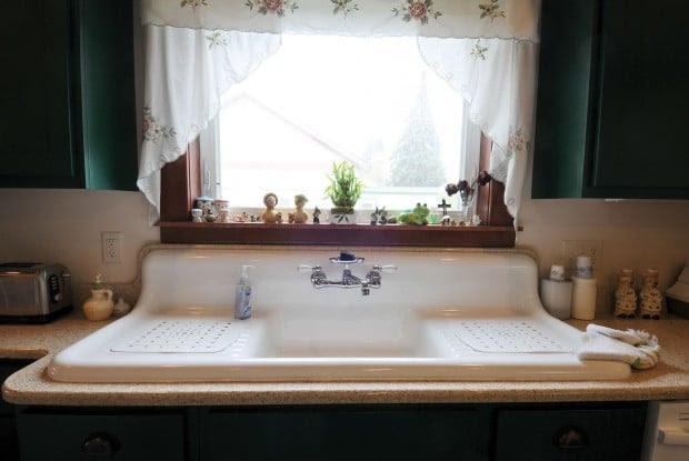 The kitchen's porcelain double-drain farmhouse sink