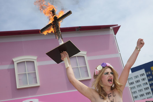 PHOTOS: Topless Protesters Target Barbie House Opening