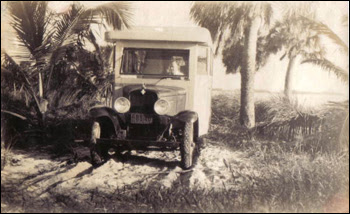 William Frost Layton in recreational vehicle on tract of land he later developed into Layton's Cottage, Trailer, and Fishing Park: Riviera Beach, Florida (ca. 1940)