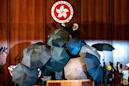 Hand signals and shields: how Hong Kong's parliament was stormed