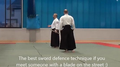 Aikido master shows students the ultimate blade defense.
