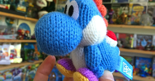 Aw. Check out this cute woolly Yoshi Amiibo toy