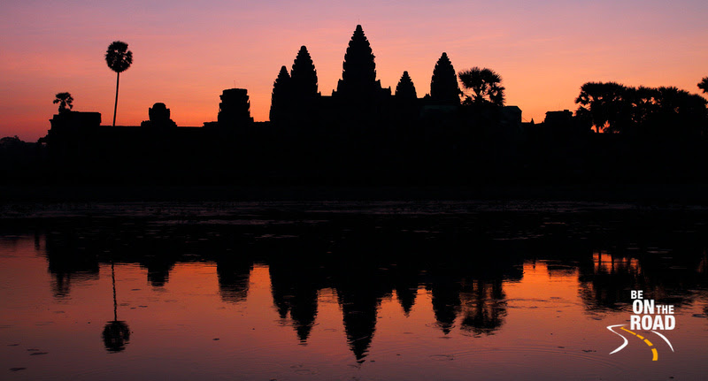 Angkor wat and its reflection at sunrise