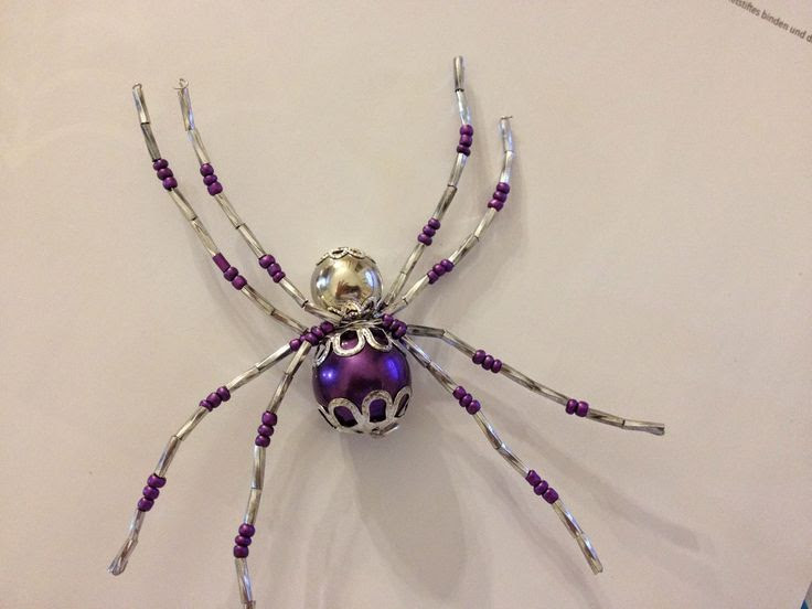 This is from Stampin'UP! Frightful Wreath Halloween kit, however....near to my heart with this spider...I always put a beaded spider like this in my Christmas tree for my now grown boys to find...I hope they carry on tradition in their families...great fun!