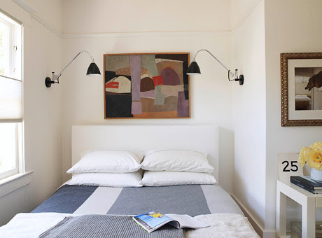White bedroom + symmetry: Gray blanket + modern art + sconces ...