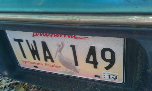 License plate on abandoned car on Bibleway Lot