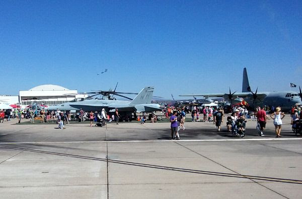 While another air demo takes place in the background, an F/A-18 Hornet, a C-130 Hercules and other aircraft are on display at the Miramar Air Show...on September 24, 2016.