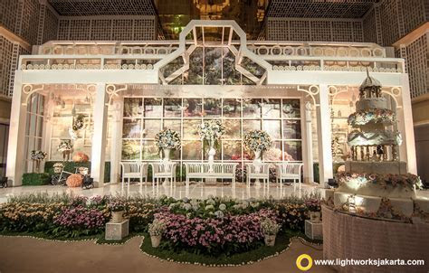 The garden theme for William and Indah wedding stage at
