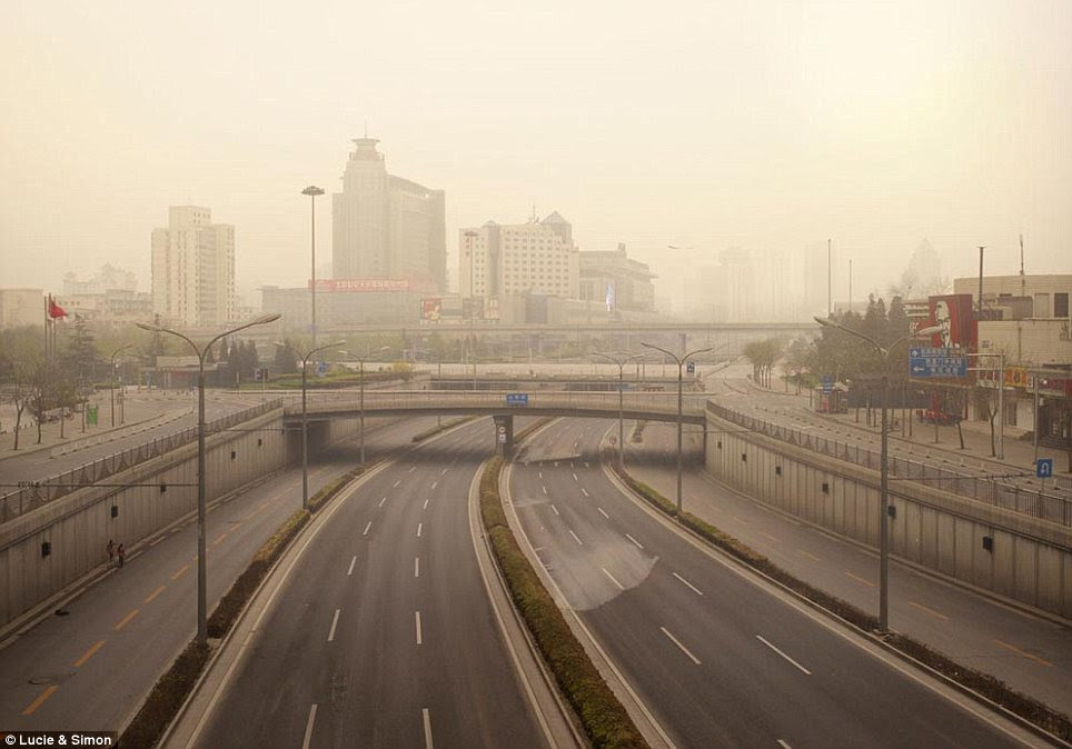 Clearing the road: Usually the sight of heavy traffic, the Xizhimen ring road looks like a scene from TV shows like The Walking Dead