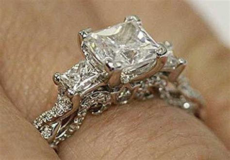 Three Stone Princess Cut Engagement Ring by Verragio (Hand