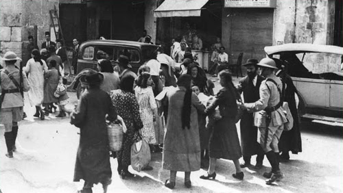 "The ""Al-Aksa is in danger"" libel and its use by the mufti led to pogroms against Jews in Israel. In the photo: Jews of the Old City being evacuated by British soldiers, 1936. (Erik Matson, Government Press Office)"