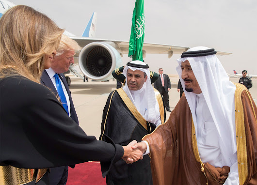Trump slammed Michelle Obama for not wearing a head scarf in Saudi Arabia, but it's OK for Melania to do the same