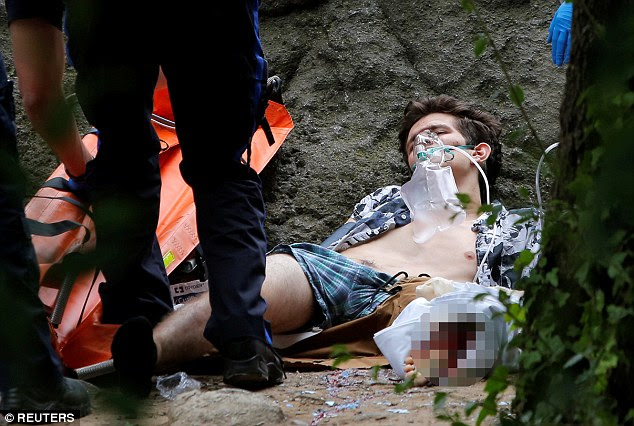 A man's leg has been partly blown off after an explosion in Central Park. He is seen being treated inside New York's historic landmarks