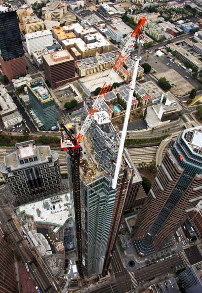 The final spire segment is about to be installed atop the Wilshire Grand Center on September 3, 2016.