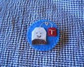 Teabag brooch