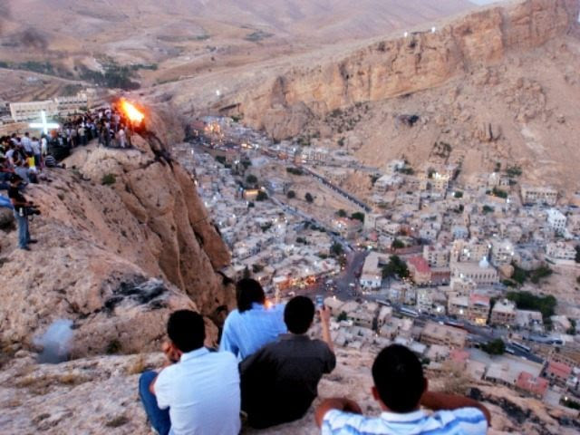 FILE - In this Wednesday, Sept. 13, 2006 file photo, Thousands of Syrians, most of them Christians, celebrate the Christian Day of the Cross, by setting a fire on top of a mountain in the village of Maaloula, north of Damascus. Syrian government troops battled al-Qaida-linked rebels over a regime-held Christian village in western Syria for the second day Thursday, as world leaders gathered in Russia for an economic summit expected to be overshadowed by the prospect of U.S.-led strikes against the Damascus regime. (AP Photo Bassem Tellawi, File)