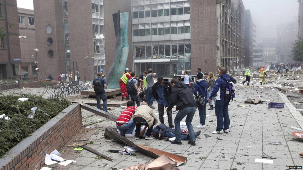Rescuers tend to an injured person after the blast in Oslo, 22 July