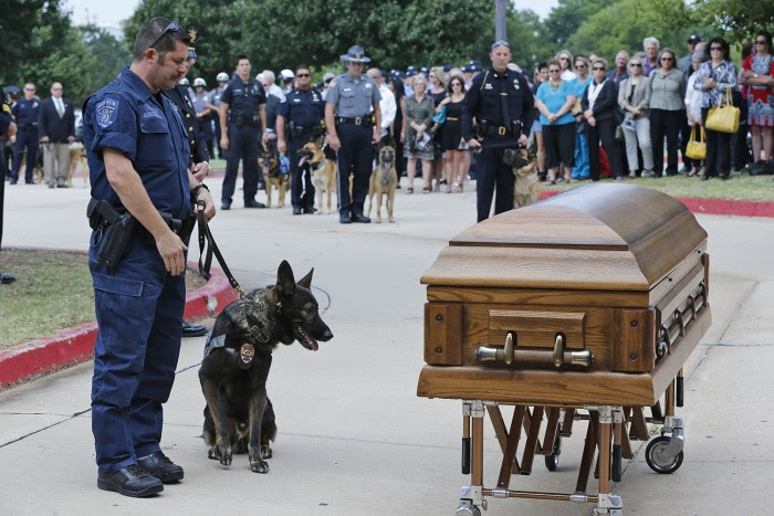 Canine officers and their handlers from around the state stopped at the casket of K-9 Kye following funeral services for the dog in Oklahoma City, Thu...