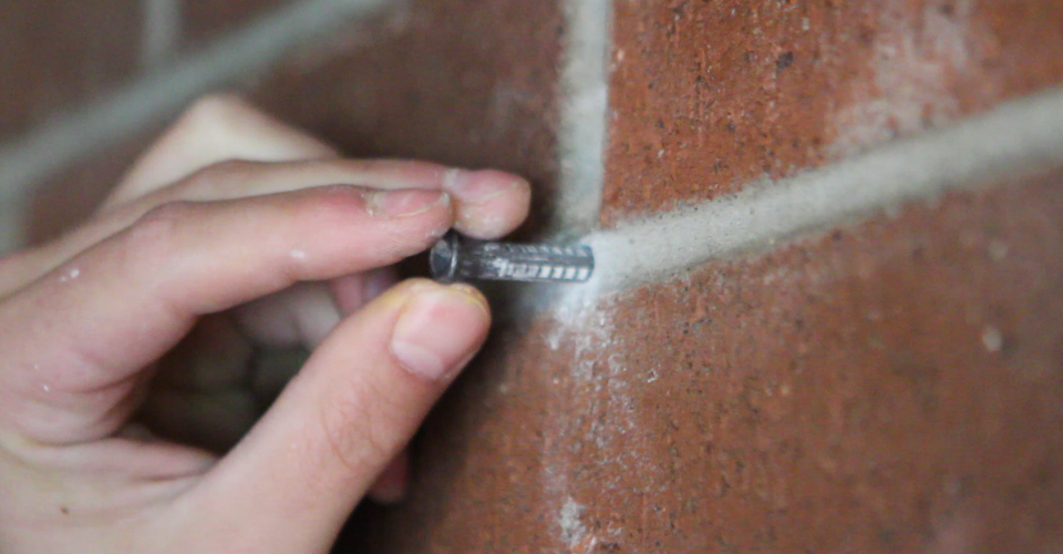 How To Drill Into A Brick Wall