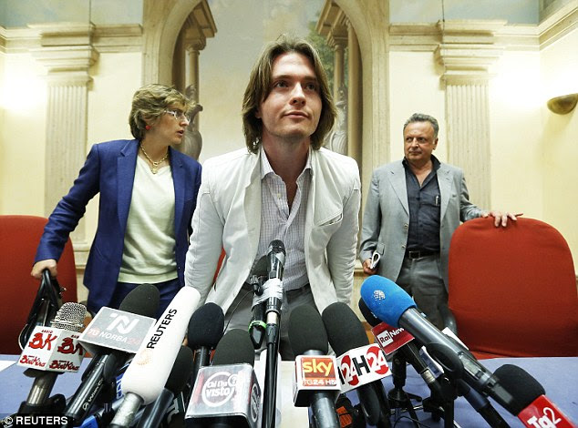 Sollecito arrives at a news conference in Rome in July last year, flanked by his lawyers Giulia Bongiorno (left) and Luca Maori (right)