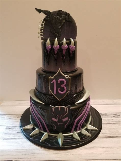 Black panther inspired cake with hand sculpted and cut
